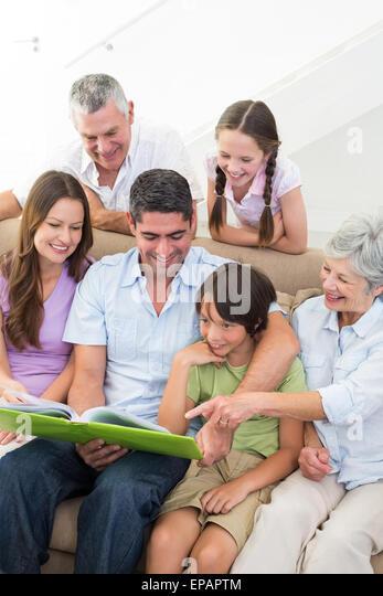 Happy family reading book - Stock-Bilder
