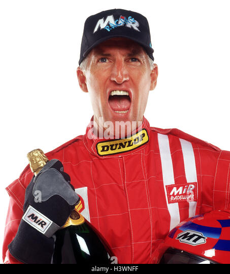 Motor sport, racing driver, overall, red, cap, Sparkling Wine Bottle, facial play, joy, cheering, victory, portrait, - Stock Image