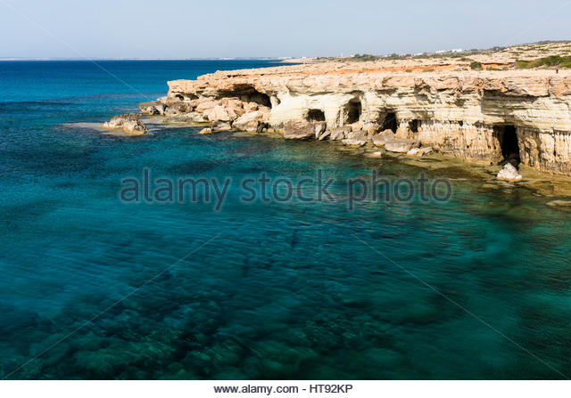 Sea Caves along Rocky Coastline by Mediterranean Sea, Cape Greco, National Forest Park, Ayia Napa, Cyprus - Stock Image