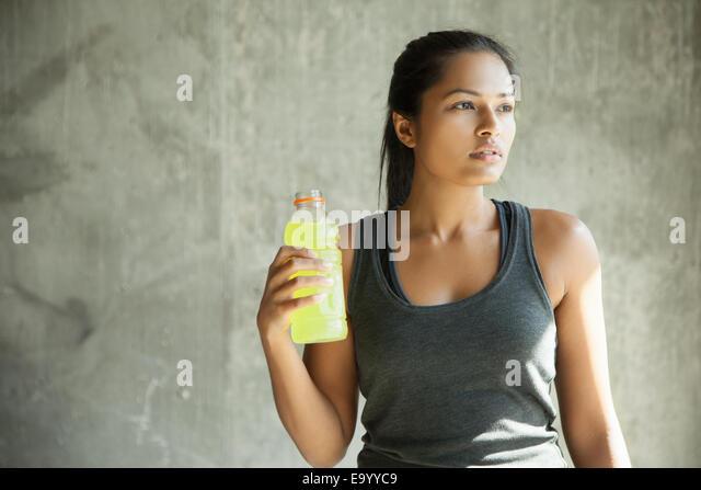 Woman with bottle of drink - Stock-Bilder