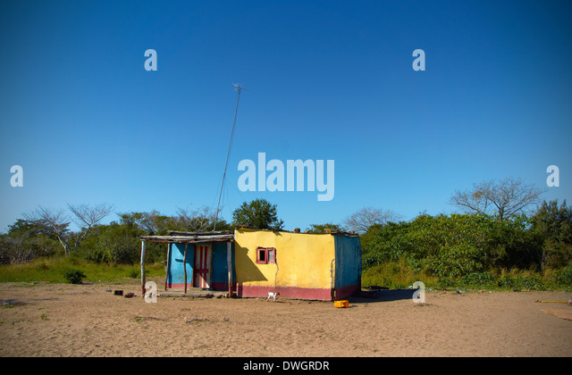 yellow house Mozambique, Africa - Stock Image