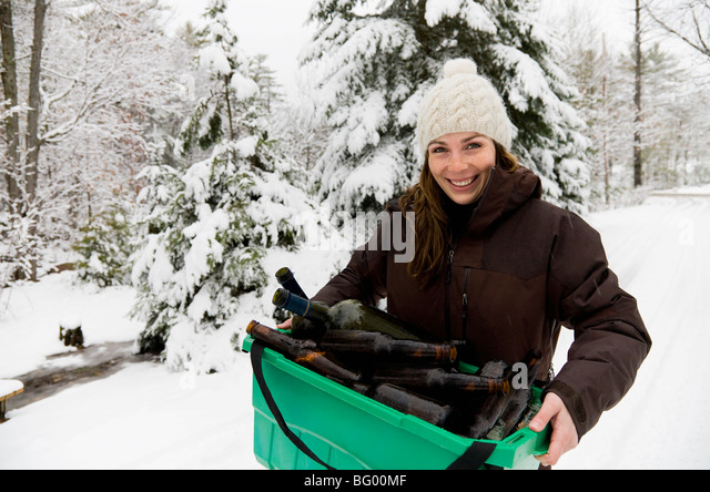 Woman carrying recycling - Stock Image