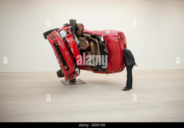Man with head inside Dirk Skerber installation Car Crash 1 at the Saatchi Gallery London - Stock Image
