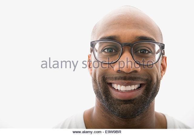 Portrait of smiling man with eyeglasses and beard - Stock-Bilder