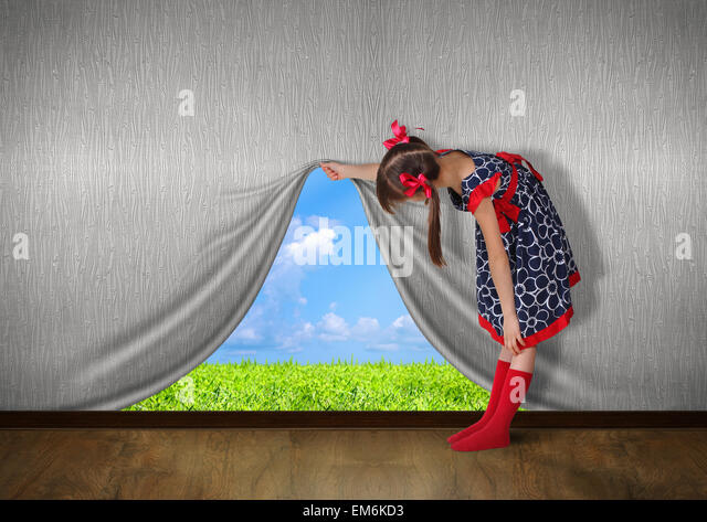 Child raise the wall and look on nature - Stock Image