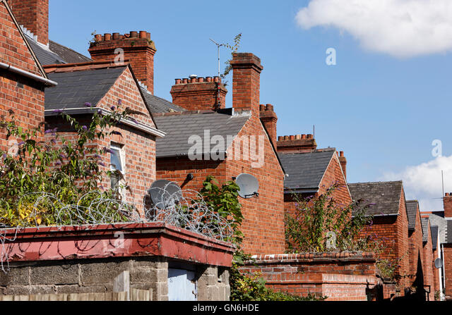 row of rear extensions on victorian terraced townhouses in the uk - Stock Image