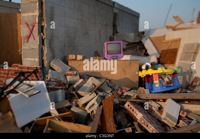 Tornado devastation in Tuscaloosa Alabama Toys laying amidst the wreckage from the mile wide tornado. - Stock Image