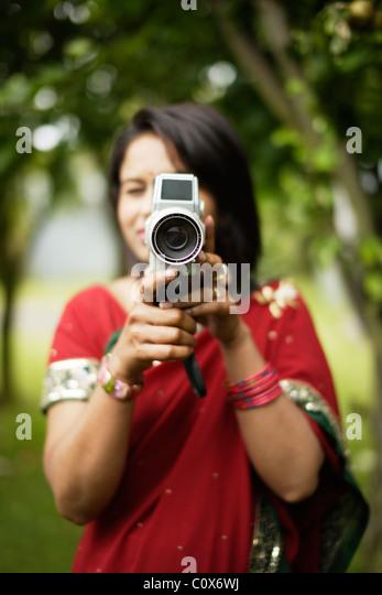 Punjabi woman with cine camera - Stock Image