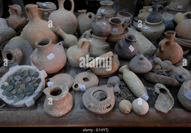 Stack of ancient items at Baidun antiquity shop located on Via Dolorosa Old city East Jerusalem, Israel - Stock Image