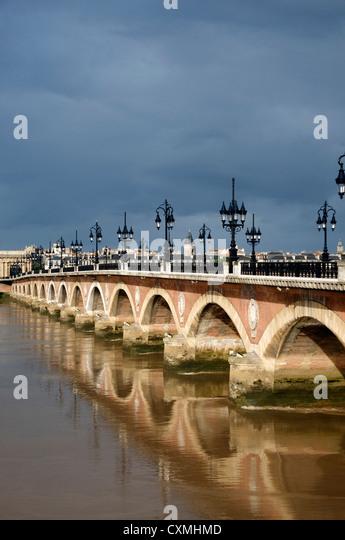 The Pont de Pierre bridge crossing the river Garonne, Bordeaux, France, Europe - Stock Image