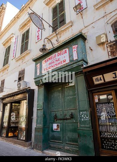 Old shop front in Trio Ir-Repubblika, Valletta, capital of the island state of Malta in the Mediterranean sea - Stock Image