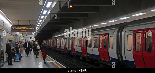 Circle Line Train and passengers,London underground,England,UK - Stock Image