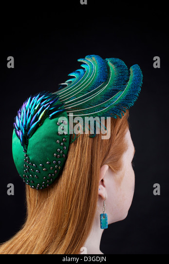 An organic hat modeled on a redhead. Handmade by Catherine Povey Milinery, Llandeilo, Carmarthenshire. - Stock-Bilder
