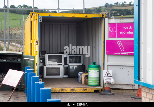 TV recycling - old TVs dumped at a waste depot, Scotland - Stock Image