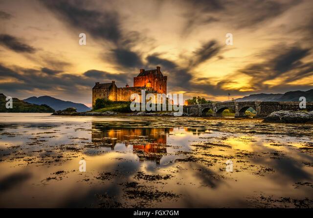 Sunset over Eilean Donan Castle, Scotland, United Kingdom. Long exposure. - Stock Image