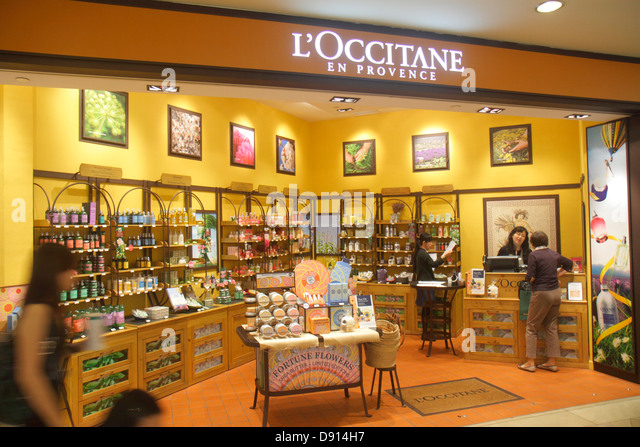 Singapore Raffles City Shopping Centre center shopping front entrance retail display for sale L'Occitane en - Stock Image