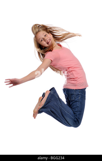 Girl jumping showing happiness isolated on a white background - Stock Image