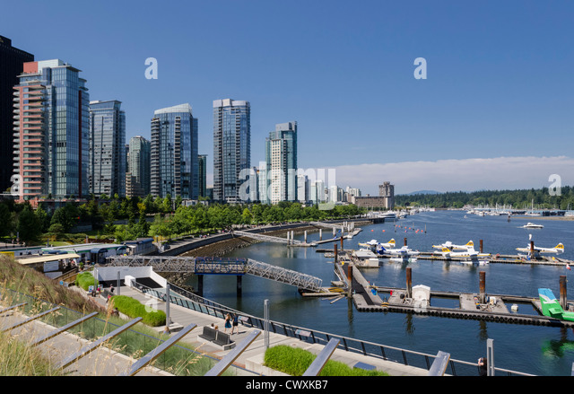 Vancouver Harbour Water Airport and apartments, West Cordova Street and Harbour Green Park, Vancouver, Canada. - Stock Image