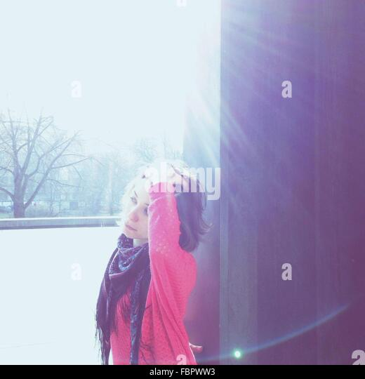 Side View Of Woman Looking Away On A Sunny Day - Stock Image