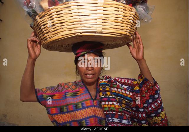 Guatemala La Antigua colonial capitol until earthquake Cakchiquel Indigenous woman sells baskets - Stock Image