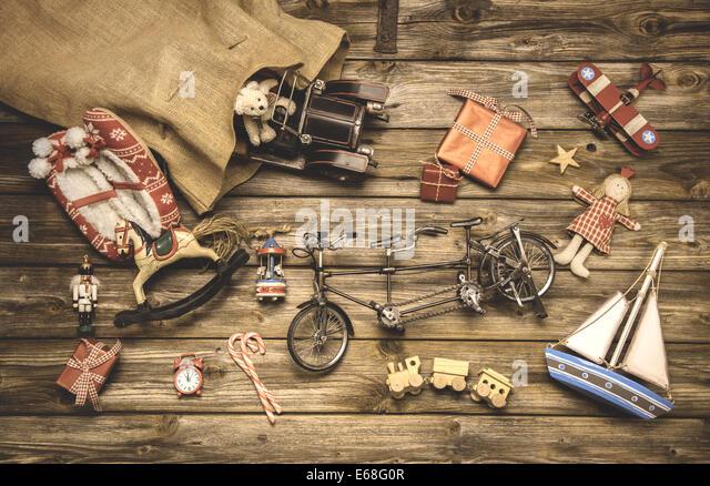 Vintage christmas decoration: old nostalgic children toys on wooden rustic background. - Stock Image