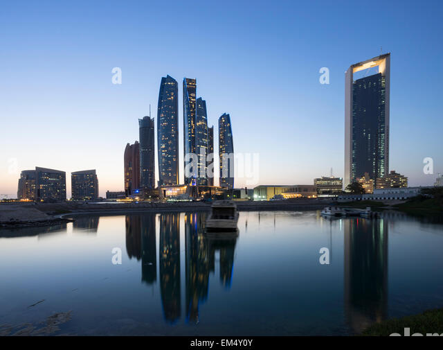 Night skyline view of Etihad Towers  in Abu Dhabi in United Arab Emirates - Stock Image