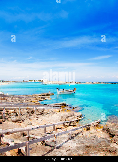 Els Pujols beach in Formentera with traditional fishing boat in summer day - Stock Image