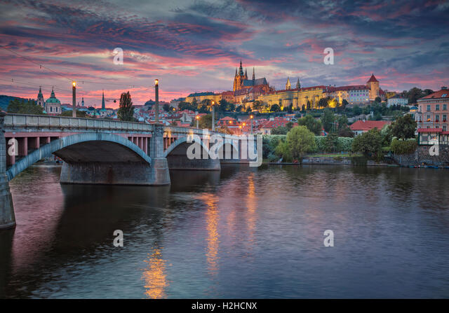 Prague at Sunset. Image of Prague, capital city of Czech Republic and Charles Bridge, during sunset. - Stock Image