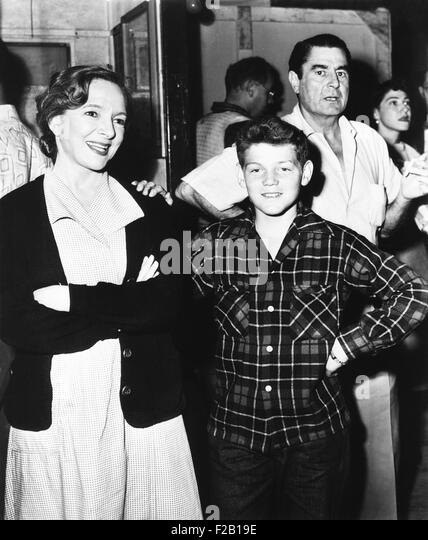 Helen Hayes, America's first actress, shows her son, Jamie MacArthur, around the Paramount set. July 1952. She - Stock Image