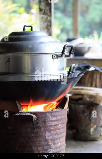 steaming pot on the brazier - Stock Image