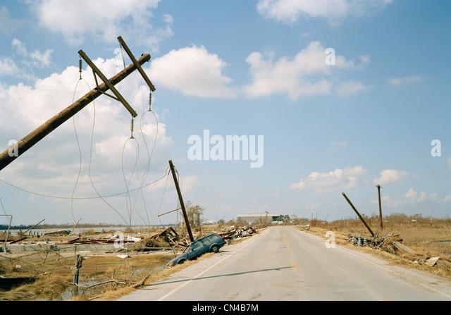 Fallen telephone poles and crashed car, aftermath of Hurricane Katrina, Cameron, Louisiana. USA - Stock Image