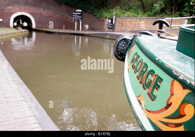 Tourests in a trip narrowboat inside Dudley Tunnel Black Country Living Museum Tipton Junction Dudley canal West - Stock Image