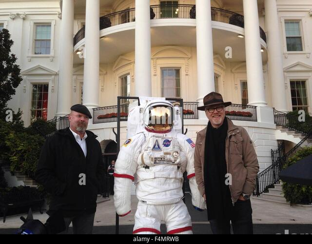 Myth busters stars Adam Savage (right) and Jamie Hyneman pose with an astronaut before the start of the second White - Stock Image
