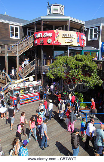 San Francisco California The Embarcadero Pier 39 entertainment Fisherman's Wharf water shopping NFL Shop business - Stock Image