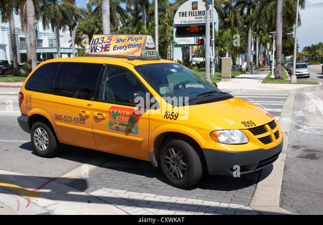 yellow minivan cab taxi in miami south beach florida usa - Stock Image