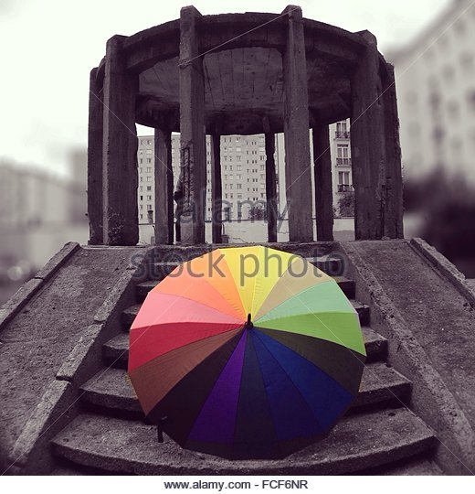 Multi Colored Umbrella On Staircase Against Built Structure - Stock-Bilder