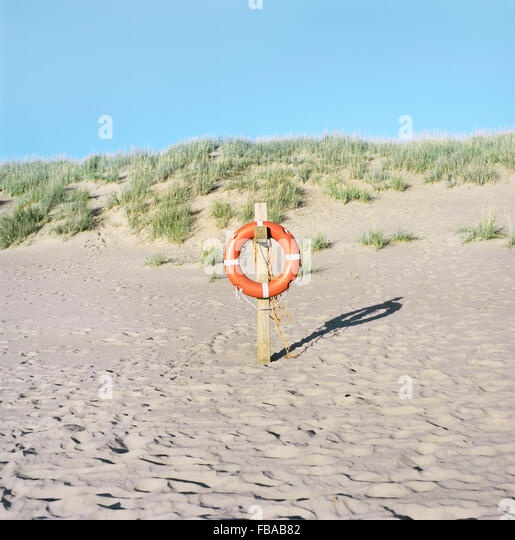 Finland, Pori, Yyteri, Life ring on sandy beach - Stock Image