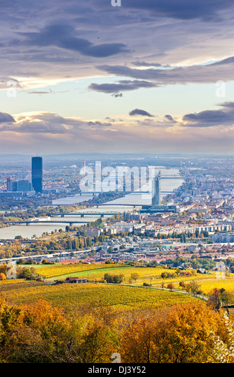 Cityscape of Vienna and Danube in the autumn at dusk - Stock Image