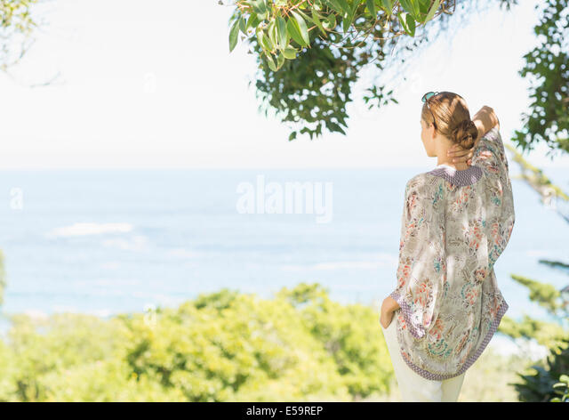 Woman overlooking rural landscape - Stock Image