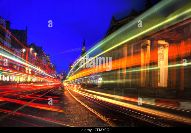 Edinburgh Princes St traffic Dusk. A night shot showing city car trails along tram lines, Scotlands capital, UK - Stock Image