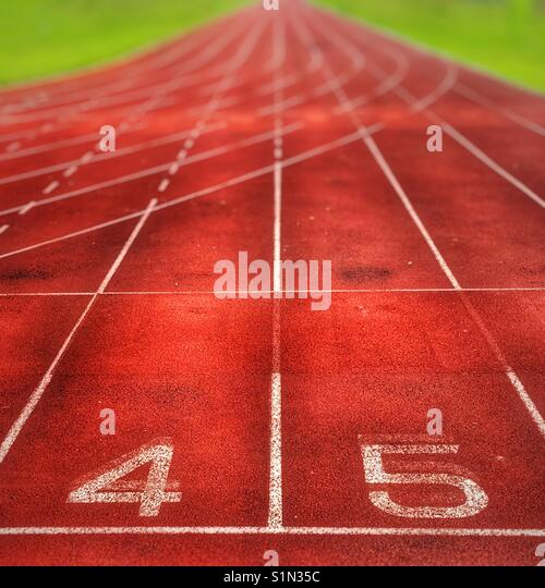 100 metres running track lanes disappearing into the distance - Stock Image