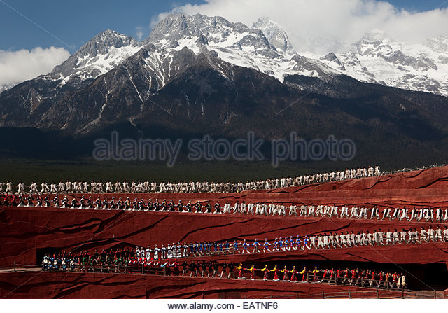 View of Impression Lijiang show on Jade Dragon Yulong Snow Mountain. - Stock Image