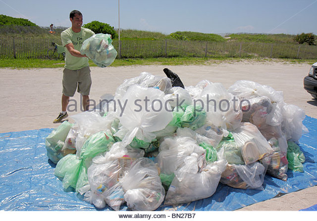 Miami Beach Florida ECOMB Big Sweep environment volunteer cleanup clean-up clean up litter trash pollution community - Stock Image