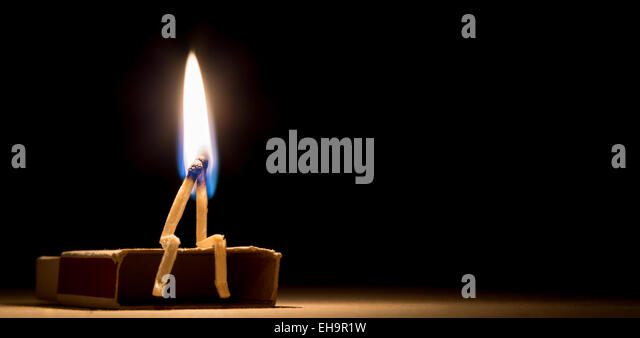 two matches in flame as a metaphor of togertherness friendship and love - Stock Image