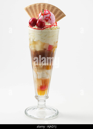 A glass of knickerbocker glory on a white background - Stock Image