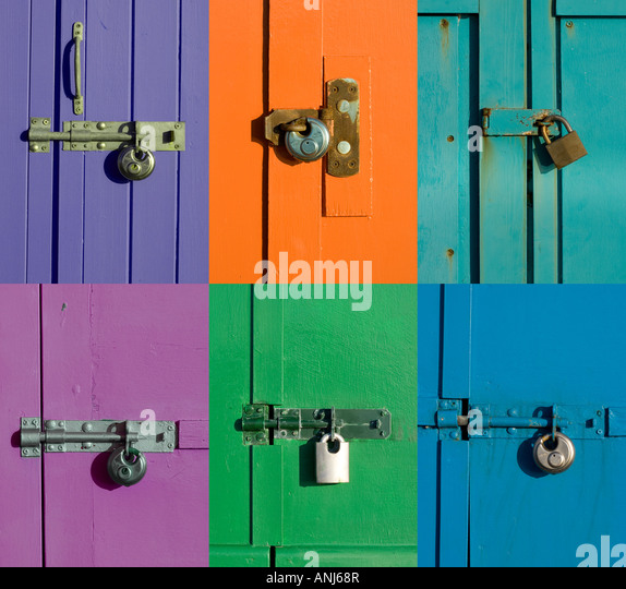 Bolts and locks on colourful doors - Stock Image