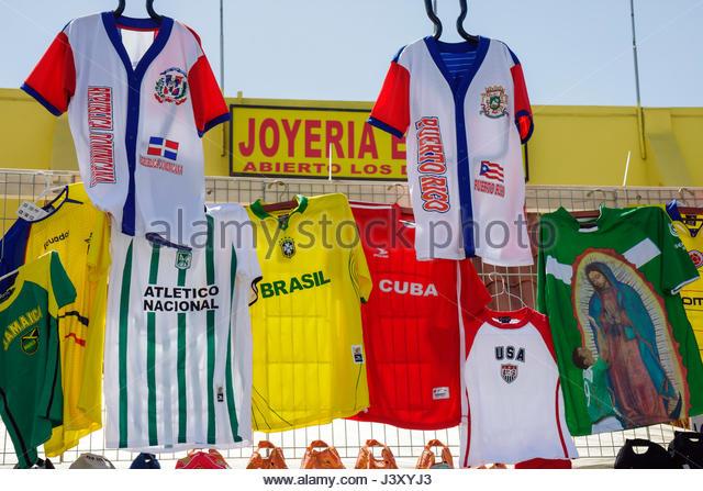 Miami Florida Little Havana Calle Ocho annual event festival street fair Hispanic vendor seller sell merchandise - Stock Image