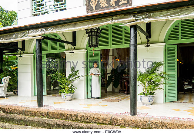 Young women at the entree of the restaurant Le Longanier in Cai Be, Mekong Delta, south Vietnam, Vietnam, Asia - Stock Image