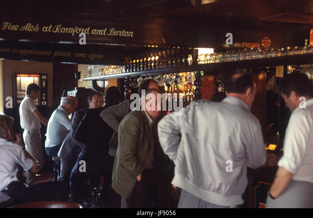 Men having a drink inside a pub - Stock Image