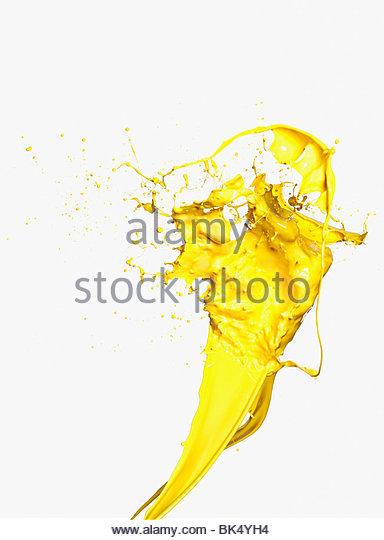 Yellow paint splashing - Stock Image